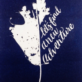 Hand processed cyanotype of leaf and lettering in darkroom.