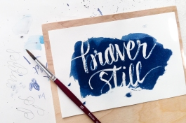 Brushed cyanotype and hand lettering in darkroom.