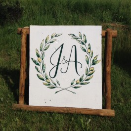 Large scale laurel and monogram painting for wedding event decor