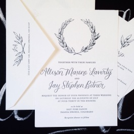 Custom letterpress wedding invitation suite with hand illustrated wreathe and hand lettered caligraphy